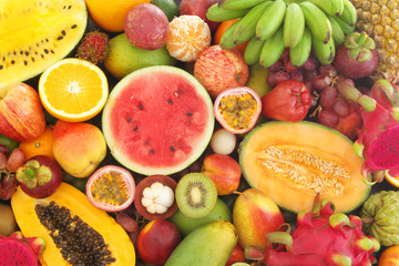 Many tropical fruits mixed together, fruit background