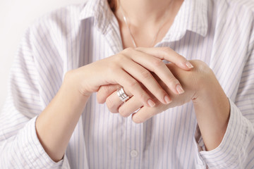 Close up image of crossed female hands