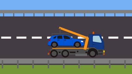 Tow truck picking up a vehicle on the road