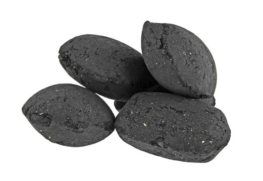 Coco charcoal briquetts isolated on white background