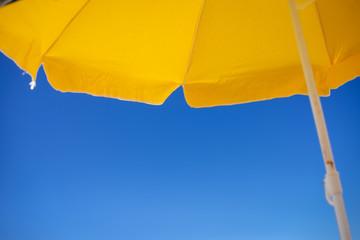 Beach umbrellas and blue sky outdoors background