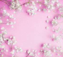 Lovely Little white Gypsophila flowers on pink background, pretty floral frame, top view, copy space, square