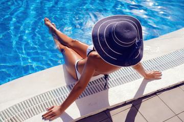 Beautiful girl in outdoor pool