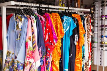 Ethnic women's clothes on hangers