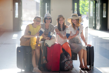 Charming tourists rejoice to the beginning of a travel.