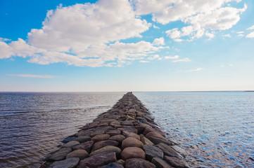 Stone pier going afar to the sea