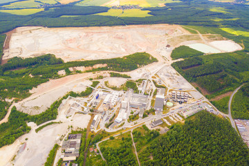 Aerial view of kaolin quarry and factory plant producing ceramic tiles. Top view of large manufacturing plant in landscape. Kaznejov, Czech republic, European union.