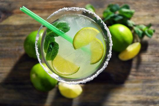 Delicious margarita cocktail on table, closeup