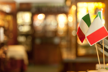 Italian Flags on Sticks close up in italian luxury restaurant dish decoration