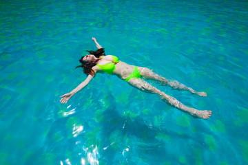 Thailand. Woman, bikini, pool