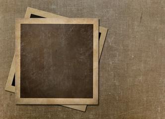 Old instant photo polaroid frames on grunge canvas