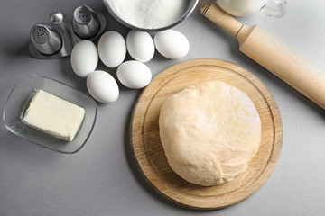 Raw dough with ingredients on kitchen table. Cooking classes concept