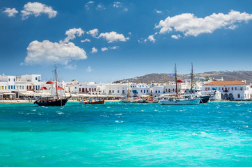 Beautiful view of the old port with white houses and boats. Mykonos town,  Cyclades Islands, Greece
