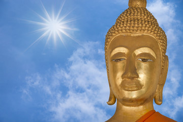 close up face of buddha with blue sky background