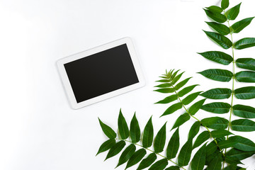 Styled natural eco home office. Tablet with copy space on white background. Product introducing Top view, flat lay.