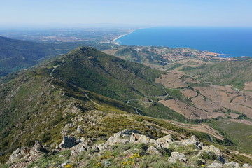 Landscape from the mountains of the massif des Alberes overlooking the Vermilion coast, Collioure and the Roussillon plain in background, Mediterranean sea, Pyrenees Orientales, south of France