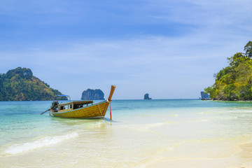 Long tail boat on a tropical island, Thailand Andaman sea.