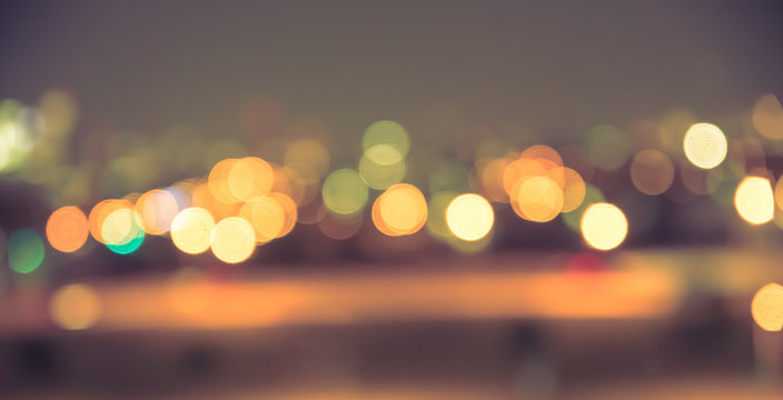 Defocused blur of city lights at night abstract with vintage tone