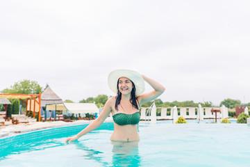 Young woman enjoying in the pool