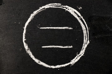 Chalk drawing as circle shape as blank stamp or seal on blackboard background