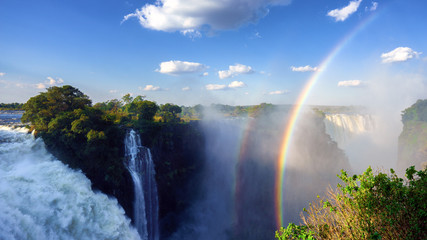 Panoramic view of the Victoria Falls and a unique vertical rainbow, Zimbabwe. (UHD 4K 16x9)