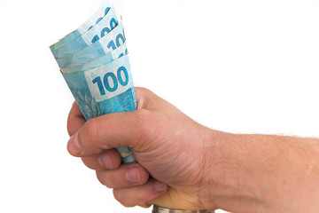 Big amount of brazilian monet in hand, concept of success.