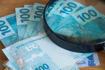 Brazilian currency, high nominal under the magnifier
