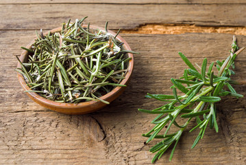 Rosemary plant in a wooden bowl