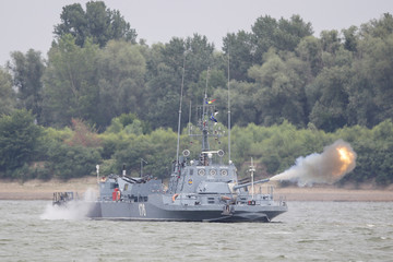 A Romanian military ship fires its main gun during one of the stages of Saber Guardian 17 military exercise in Bordusani