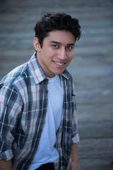 Teenage Hispanic boy, smiling