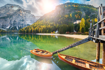 Wall Mural - Wooden boats on the alpine lake, Dolomites, Italy, Europe