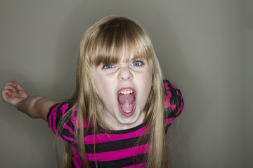 Young girl screaming at the camera