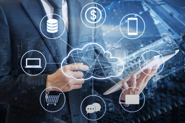 Double exposure of professional businessman connecting cloud technology network and devices on hand with tablet and cityscape & data center background in technology, communication and business concept
