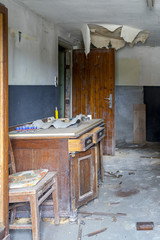 EISENBERG Germany- July 17, Abandoned office with dusty desk in Eisenberg Germany, July 15, 2017 in Eisenberg, Rhineland-Palatinate, Germany