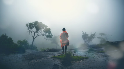Asian man travel sleep relax. Morning atmosphere nature Forests. walk in the forest rainy season. puhinrongkla Thailand