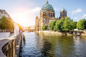 Sunrise view on the riverside with Dom cathedral in the old town of Berlin city
