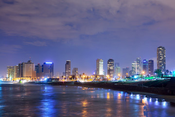 TEL AVIV, ISRAEL - APRIL, 2017: View of the night Tel Aviv and the Mediterranean Sea at Night. The famous tourist view of modern Tel Aviv.