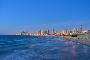 TEL AVIV, ISRAEL - APRIL, 2017: Evening view of the skyscrapers of Tel Aviv from the Mediterranean Sea.