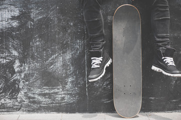 Legs in sneakers at the skateboard