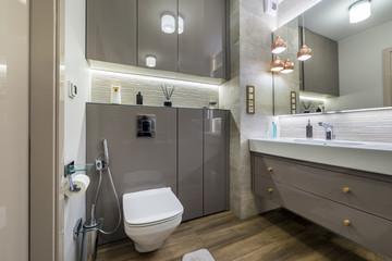 Modern bathroom with wooden floor
