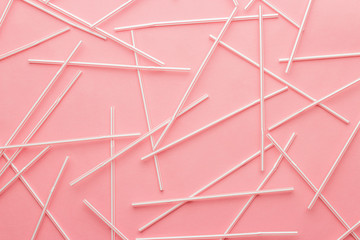 red striped bendy cocktail straws on pink background