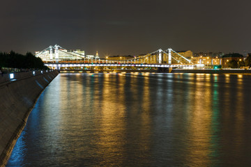 Crimean bridge with night illumination. Moscow river with night illumination. Crimean embankment, Moscow, Russia.