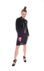 Woman in black dress standing.