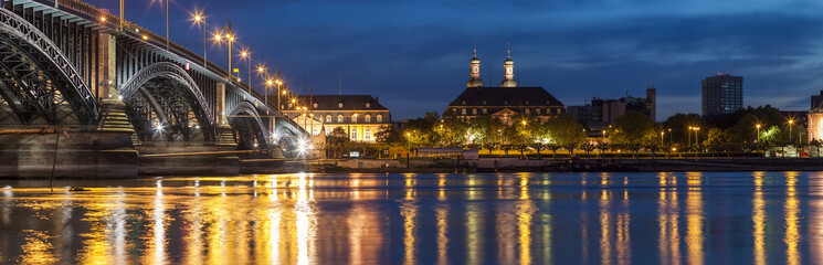 Beautiful sunset night over Rhine / Rhein river and old bridge in Mainz near Frankfurt am Main, Germany.