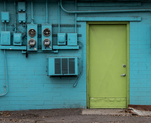 Green door in blue house