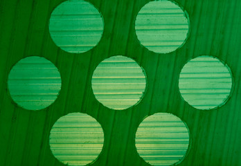 background texture gradations on green plastic with circles