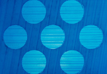 background texture gradations on blue plastic with circles