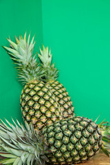 Fresh Tropical pineapples on green background