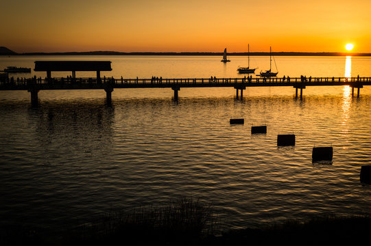 Sunset scene of boats and the boardwalk
