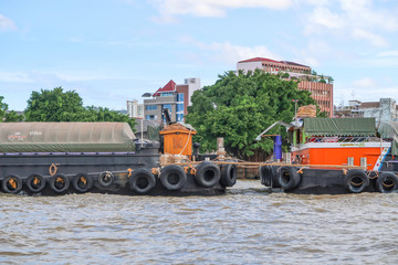 BANGKOK, Thailand - July 7, 2017 : Tug boat cargo ship in Chao Phraya river at Bangkok, Thailand